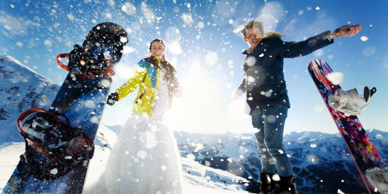 bride and groom in love throw snow background of the Alps Courchevel